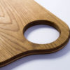 Gauchas Thin Cutting Board With a Hole close up